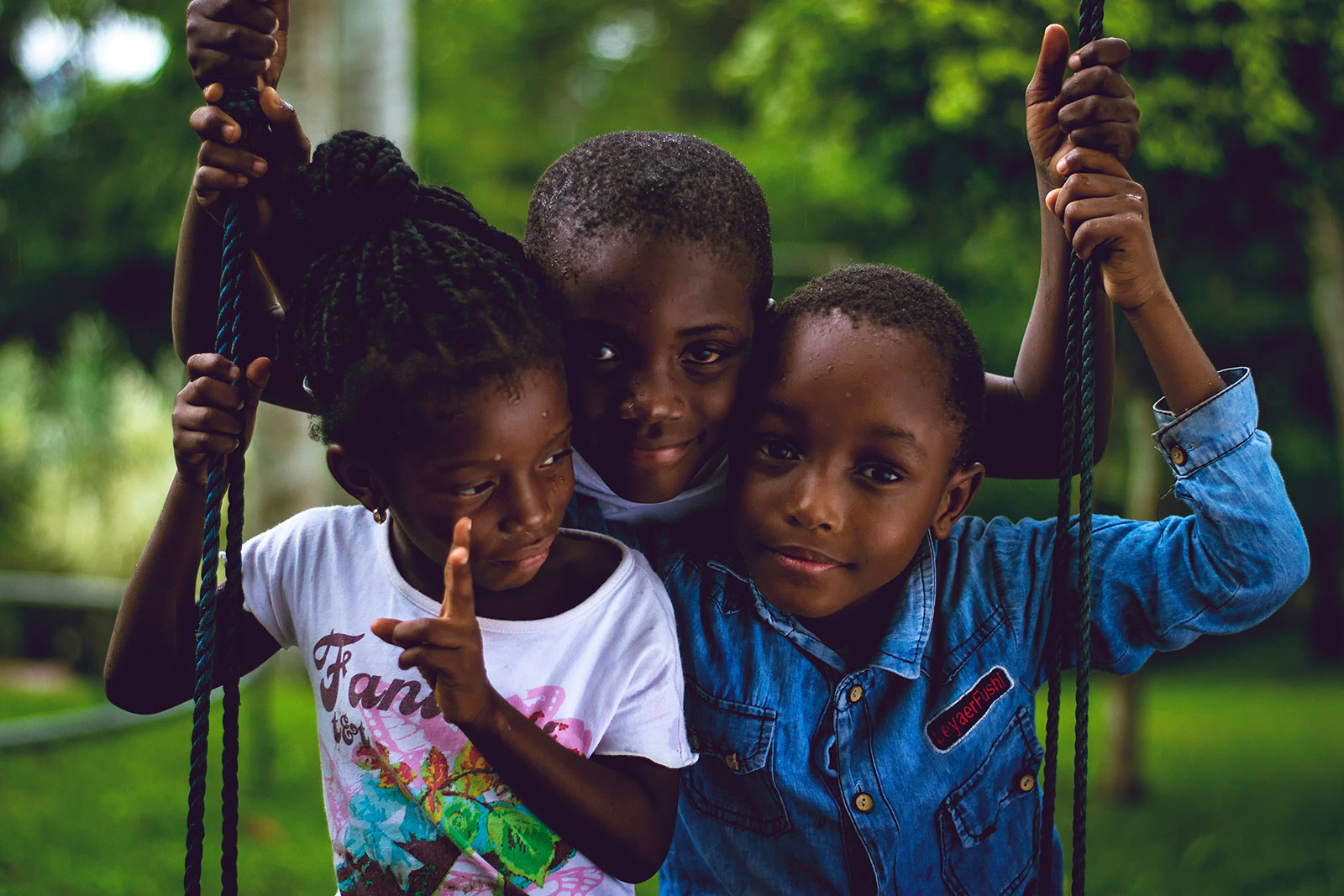3 kids on swing